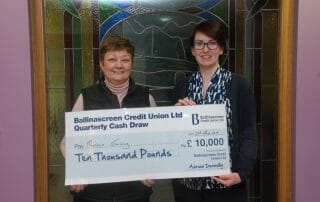 Maureen Conway cash draw winner receiving her cheque from Kathleen O'Hagan